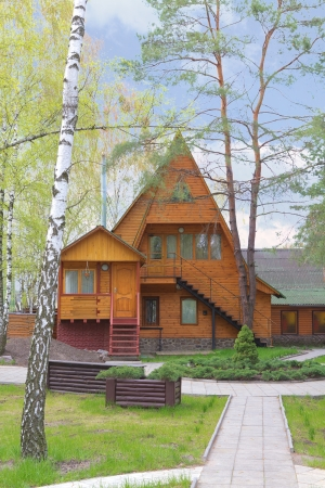 wooden house in the countryside in Ukraine photo