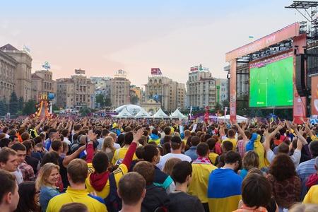 KIEV, UKRAINE - JUNE 15: Ukrainian, Swedish and English fans in the fanzone before match Euro 2012 between Ukraine - France and England - Sweden on June 15, 2012 in Kiev, Ukraine. Zone for the fans UEFA EURO Championship on Kreshatik street.