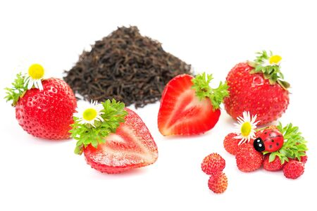herbal black fruit tea with strawberry, on white background photo