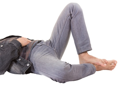 legs of young male lying on the floor, isolated on white background photo