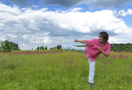 Man practicing karate kick in spring field Stock Photo - 14426164