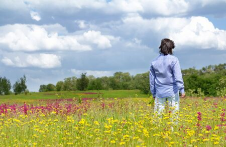 Man standing in the middle of a green meadow Stock Photo - 14426165