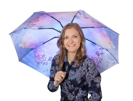 Pretty young woman under a blue umbrella, isolated on white background photo