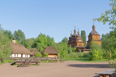 Small village and wooden church. rural landscape photo