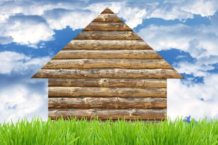 Eco wooden house concept against blue sky background photo