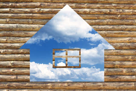 House icon made out of wood plank, on blue sky background  photo