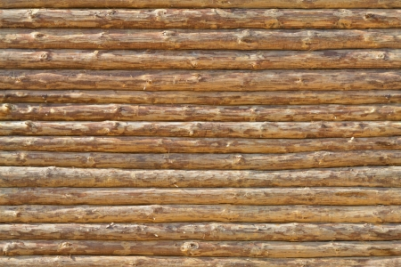 Wall of the rural house made from wooden logs. Seamless texture photo