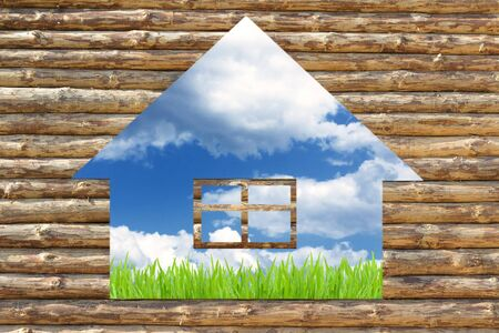 wooden house with green grass on blue sky background photo