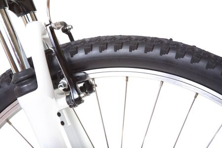 Wheel with tire of mountain bike, isolated on white background, close up photo
