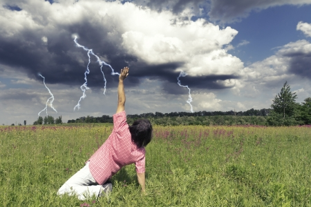 Man stopping thunders and lightning in the field photo