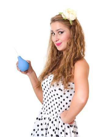 beautiful pin up girl with the enema isolated on white background photo