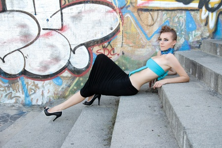 Beautiful cyber futuristic woman lying on steps photo