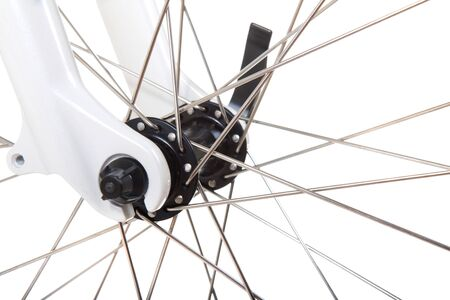 Close up of the front wheel of a bicycle isolated on white background photo