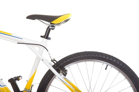 Wheel with tire and saddle of mountain bike close up isolated on white background