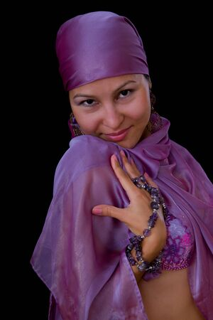 Pretty young Asian Muslim woman - belly dancer isolated on black background photo