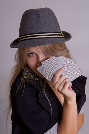 pretty blond woman in hat with playing cards photo