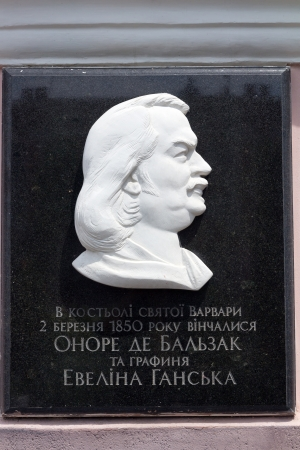 memorial plaque: Honore de Balzac on memorial plaque on Roman Catholic Church of St. Barbara in Berdychiv, Ukraine, is known for wedding of famous french writer Honore de Balzac and Evelina Ganska in 1851 Stock Photo
