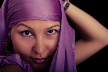 Beautiful Asian Muslim woman on black background photo