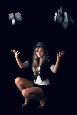 Young Beautiful blond woman in hat throwing poker cards