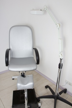 Chair for tweezing eyebrow in beauty salon / cosmetology Clinic photo