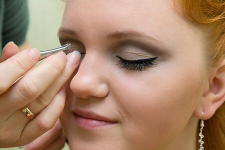beautiful young model getting fashion make-up and eyelash extension Stock Photo - 16715481