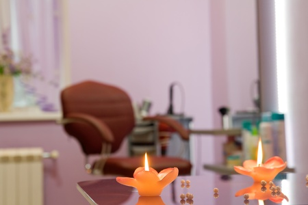 interior of luxury beauty salon - workplace hairdresser, focus on candles photo
