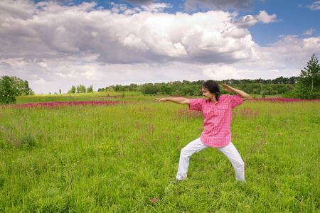 Man practicing funny fighting in a spring field Stock Photo - 17051727