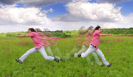 Young men running away from something outdoors Stock Photo - 17134517
