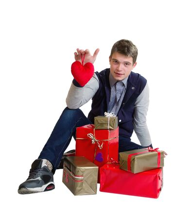 Valentines Man /  Teenager holding heart and gifts isolated on white background Stock Photo - 17370182