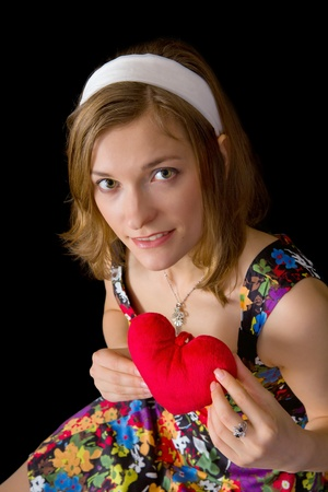 Beautiful pin up girl holding toy heart Stock Photo - 17370197