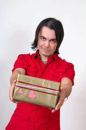 Pretty young Valentines Man holding a gift Stock Photo - 17370183