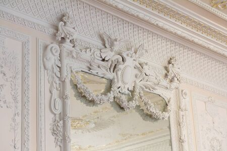 White antique mirror frame molding in a palace photo