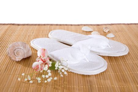 Spa or hotel flip flops on a bamboo mat photo