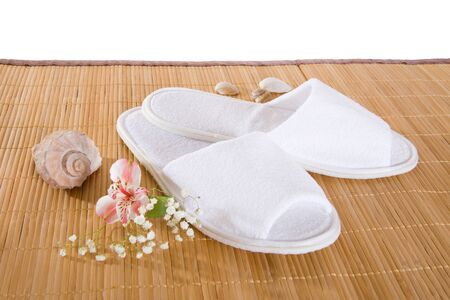 Spa or hotel slippers on a bamboo mat Stock Photo