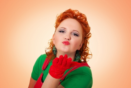 Beautiful curly pinup girl blowing a kiss Stock Photo - 17621783