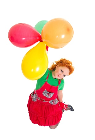 Happy beautiful girl flying with balloons and looking up Stock Photo - 17621759