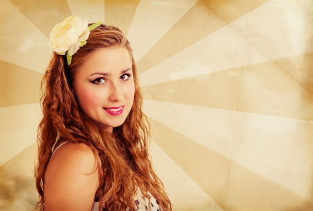Young beautiful girl with flower in her long curly hair in pin up style on striped retro background Stock Photo - 17797032