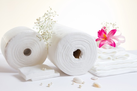fabric roll: Spa accessories: white sheets and towels on white background Stock Photo
