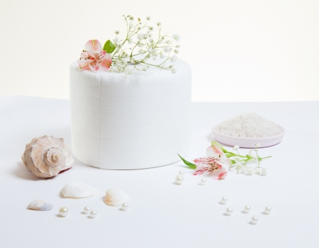 Toilet paper roll with natural flowers and seashells photo
