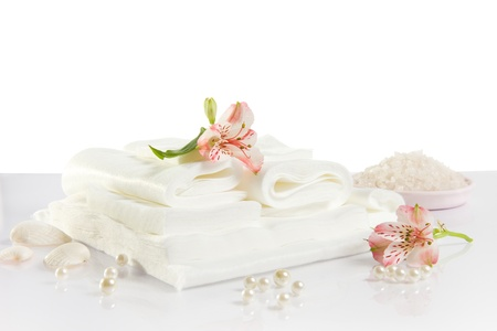 Spa accessories: white sheet, towels and sea salt