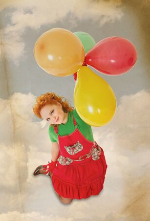 Happy beautiful girl flying in clouds with balloons and looking up, toned in retro style Stock Photo - 17797028