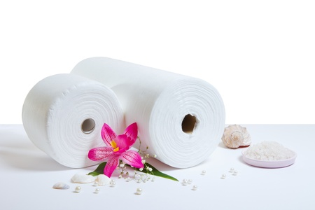 Spa accessories: white rolled towels isolated on white background