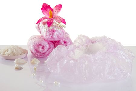 Spa accessories - disposable shower cap and flowers photo