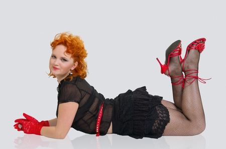 Beautiful girl with red hairs lying on the floor photo