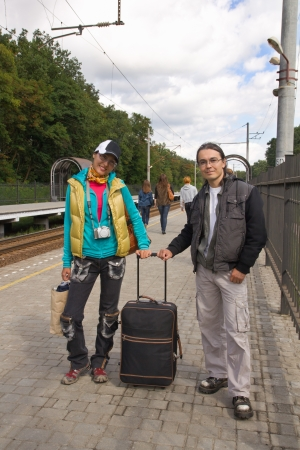 Man and woman with baggage waiting for train  photo