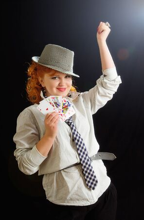 The young beautiful woman with poker playing cards photo