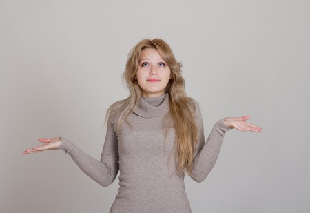Portrait of a beautiful slim businesswoman in gesture of asking and confusion Stock Photo