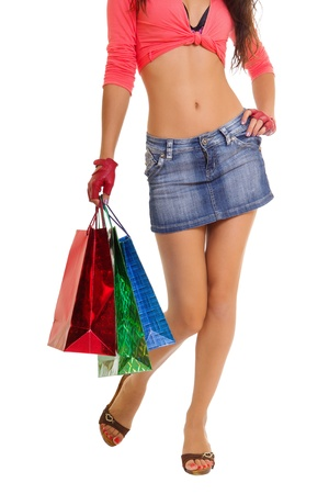 Closeup of woman holding shopping bags, isolated on white Stock Photo - 19249291