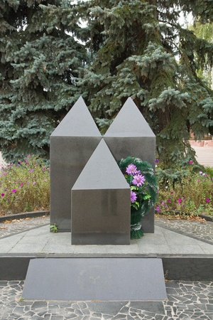 Monument dedicated to victims of Chernobyl Power Plant technological catastrophe in Korosren, Ukraine. Ecological disaster happened on April 26, 1986.
