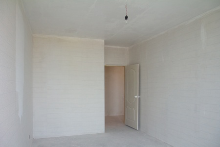 building repair - empty room with white wallpaper photo